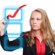 Business woman drawing a virtual red check mark — Stock Photo #12197491