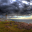 Lighthouse cloudscape in HDR — Stock Photo