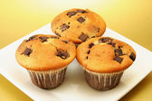 Three choc chip muffins — Stock Photo