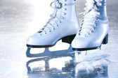 Dramatic landscape blue shot of ice skates — Stock Photo