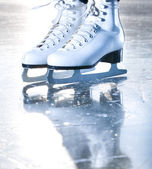 Dramatic blue portrait shot of ice skates — Stock Photo