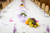 Wedding or reception dinner table with fruits — Stock Photo