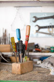 Set of used screwdrivers in workshop — Stock Photo
