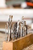 Detail of drills on workshop table, shallow focus — Stock Photo