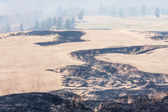 Traces of controlled grass burning near Mount Aso — Stock Photo