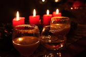 Goblets and burning candles — Stock Photo