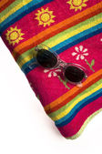 Towel and sun glasses — Stockfoto