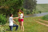 Love story. Wheatfield, Pine, Strawberry in hand — Stock Photo