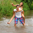 Love story. Running along the river, splashing - Photo