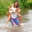 Stock Photo: Love story. Running along river, splashing