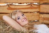 Girl on the hayloft — Stock Photo
