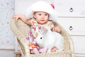 Little baby girl with rabbit — Стоковое фото