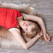 The beautiful blonde in a red dress — Stock Photo