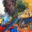 Paint brush and canvas - Stock Photo