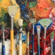 Artist brushes on an oil painting background - Stock Photo