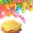 Stock Photo: Birthday cupcake with balloons and ribbons.