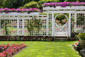 Rose garden gate — Stock Photo
