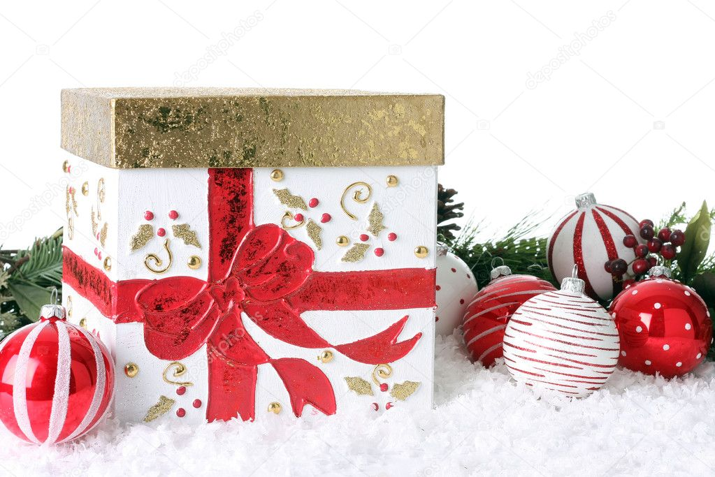 Christmas gift box with snow and ornaments.  Stock Photo #11105957