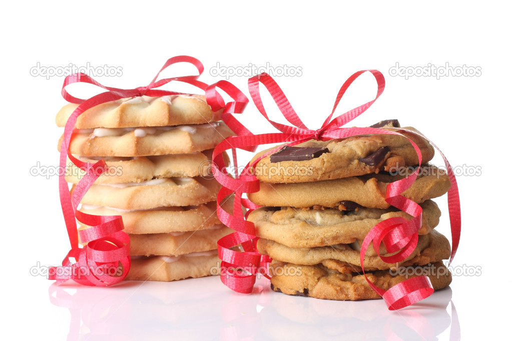 Christmas cookies, shortbread and chocolate, wrapped in a red bow. — Stock fotografie #11106050