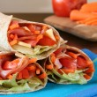 Stock Photo: Healthy lunch, ham, cheese and vegetables wrapped in whole wheat tortilla.