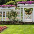 Rose garden gate - Stock Photo