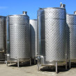 Fermentation tanks at a winery. - Stock Photo
