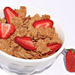 Bowl of healthy breakfast cereal with fresh strawberries. — Stock Photo
