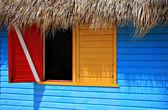 Little colorful caribbean window. — Stock Photo