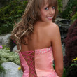 Beautiful blond teenage girl in prom dress - Stock Photo