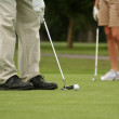 Man putting, woman in background, shallow dof — Stock Photo