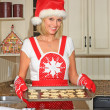 Woman baking cookies — Stock Photo #11347035