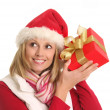 Santa lady and the gift — Stock Photo