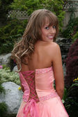 Beautiful blond teenage girl in prom dress — Stock Photo