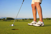 Lady golfer putt — Stock Photo