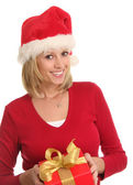 Christmas lady and a present. — Stock Photo