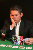 Poker player contemplating his next move — Stock Photo