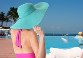 Vacation lady wearing a sun hat. — Stock Photo