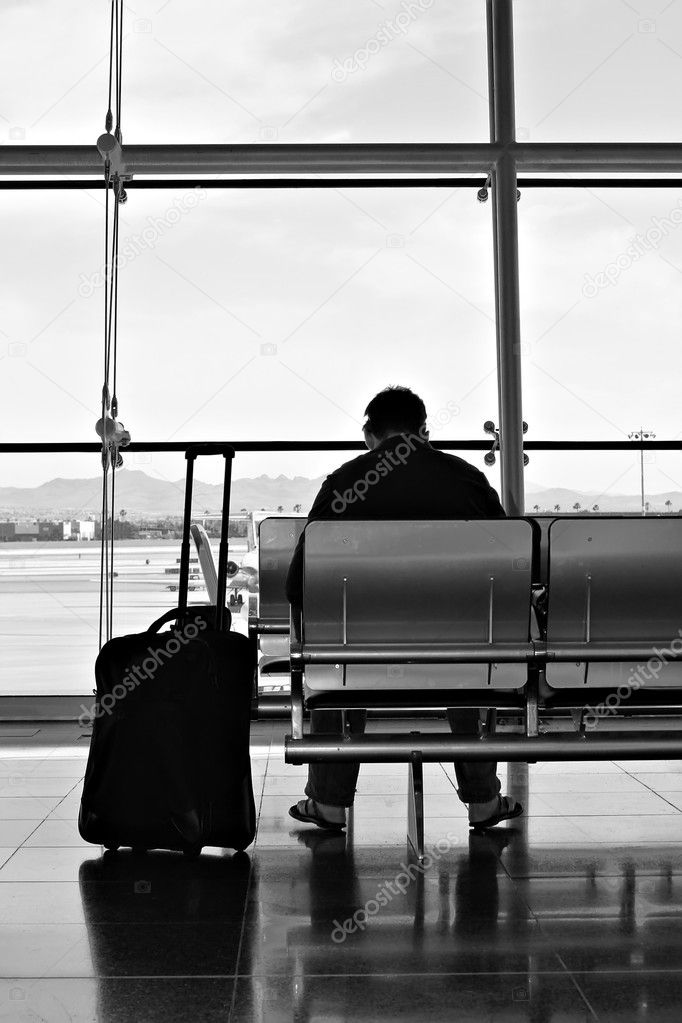 Commuter waiting for his flight — Stock Photo #11340666