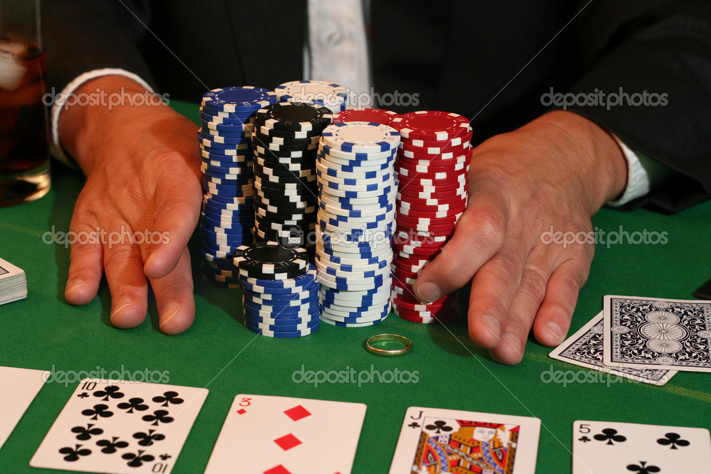 All in! Man pushes in all his chips and his gold wedding ring. — Stock Photo #11340696