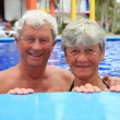 Senior couple in swimming pool. — Stock Photo