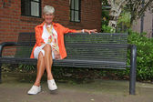 Senior lady in the park — Stock Photo