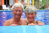Senior couple in swimming pool. — Stok fotoğraf