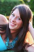 Beautiful brunette teenager outside at sunset — Stock Photo