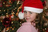 Cute girl wearing Santa hats — Stock Photo