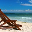 Lounge chairs on a tropical beach - Stock Photo