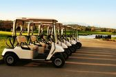 Golf carts, lined up — Stock Photo