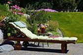 Sun-lounger in a garden — Stock Photo
