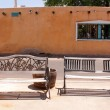 Stock Photo: Old bench infront MexicHouse.