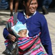 Bolivian woman with child — Stock Photo #12157540