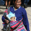 Bolivian woman with child — Stock Photo